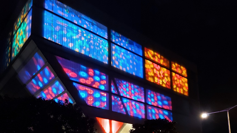 Geelong Art Cent're Ryrie Street Building illuminated in purple, blue, orange and red colours